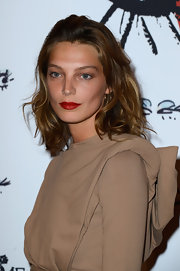 A big and bold red lip color brought out the golden undertones of Constance's skin.