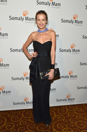 Petra Nemcova went for classic glamour with this strapless black column dress at the Life is Love Gala.