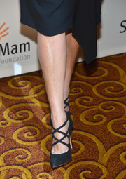 Katie Couric went the Life is Love Gala wearing a pair of elegant black strappy pumps.