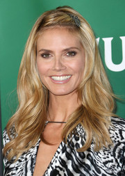 Heidi Klum looked lovely with her feathered waves during NBCUniversal's Summer Press Day. The pinned-up bangs added a youthful touch.