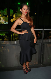 Preeya Kalida chose ruffled, peplum dress with an asymmetrical hem for the Novak Djokovic Foundation Dinner.