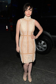 Ashley Rickards was a stunner in an embellished nude turtleneck dress by Michael Cinco during the People's Choice Awards.