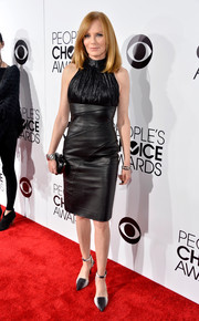 Marg Helgenberger went for an edgy-chic flair with this black leather turtleneck dress by Rubin Singer during the People's Choice Awards.