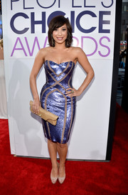 Cheryl Burke showed off her fab physique in a sequined blue strapless dress during the People's Choice Awards.