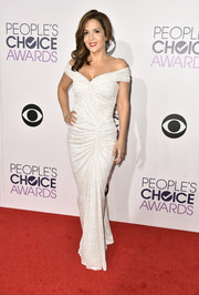 Maria Canals-Barrera chose a ruched white off-the-shoulder gown for her People's Choice Awards look.