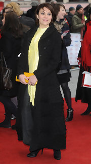 Helen McCrory chose an ankle-length evening coat with ruched detailing for her sophisticated red carpet look.
