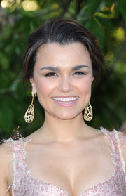 Samantha Barks attended the Serpentine Gallery Summer Party wearing massive cocoon-like dangling earrings.