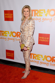 Arianna Huffington shimmered in a gold jacquard pantsuit during the TrevorLive NY event.
