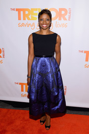 Montego Glover went for classic elegance at the TrevorLive NY event in a sleeveless cocktail dress with a floral brocade skirt.