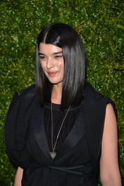 Crystal Renn styled her black outfit with an inverted-triangle pendant for the Tribeca Film Festival Artist Dinner.