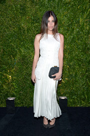Julia Restoin-Roitfeld was immaculate in white at the Tribeca Film Festival Artists Dinner, wearing this sleeveless dress featuring a textured bodice and a pleated skirt.