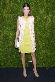 Giovanna Battaglia went for a vibrant retro look with this colorful sleeveless coat and yellow zip-front dress combo at the Tribeca Film Festival Artists Dinner.