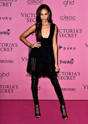 Joan Smalls contrasted her girly dress with super-edgy black thigh-high boots by Givenchy, featuring open toes and lace-up detailing.