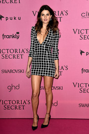Isabeli Fontana put her curvy physique on display in a body-con grid-patterened sequined dress by Balmain at the Victoria's Secret after-party.