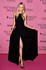 Eniko Mihalik opted for a simple sleeveless black gown with a thigh-high slit when she attended the Victoria's Secret fashion show after-party.