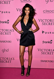 Imaan Hammam looked stylish and sexy in a low-cut wrap LBD during the Victoria's Secret fashion show after-party.