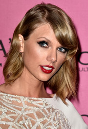 Taylor Swift styled her hair with subtle waves and side-swept bangs for the Victoria's Secret fashion show after-party.