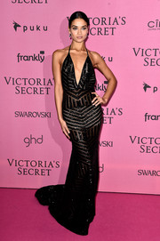 Shanina Shaik was all about sultry glamour in a beaded black halter gown with a plunging neckline at the Victoria's Secret fashion show after-party.