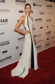 Alexandra Agoston opted for modern glamour in a white, black, and gray gown when she attended the amfAR Inspiration Gala.