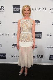 Gretchen Mol sealed off her vintage-chic look with a pair of silver and black evening sandals.