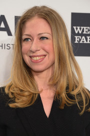Chelsea Clinton sported a stylish layered cut with wavy ends during the amfAR New York Gala.