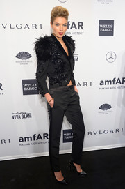 Jessica Hart made a fabulous choice with this sequined and feathered Louis Vuitton jacket at the amfAR New York Gala.
