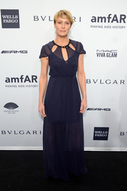 Robin Wright chose a simple yet girly Kate Sylvester gown with neckline cutouts for the amfAR New York Gala.