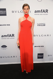 Elettra Wiedemann went the modern route in a geometric red-orange halter gown by Ana Khouri during the amfAR New York Gala.
