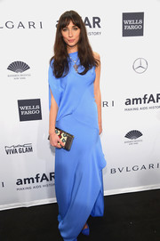 Rebecca Dayan styled her gown with a colorful printed clutch.