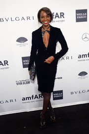 Kiara Kabukuru sizzled in a cleavage-revealing black skirt suit during the amfAR New York Gala.