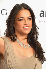 Michelle Rodriguez attended the amfAR New York Gala wearing a messy wavy cut.