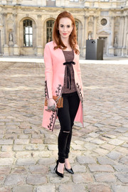 Tatiana Pauhofova contrasted her dainty coat with edgy ripped jeans.