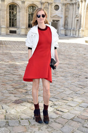 Elizabeth Von Guttman chose a sporty-chic red mini teamed with a white jacket for her Christian Dior show-going look.