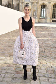 Klara Issova paired her dress with a classic quilted purse, also by Dior.