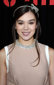 Hailee Steinfeld amped up the cuteness with a bedazzled bow headband.