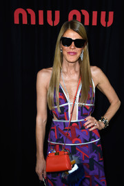 Anna dello Russo wore red nail polish with her multicolored dress for a totally vibrant look during the Miu Miu show.