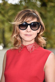 Clotilde Courau sported shoulder-length waves with side-swept bangs at the Valentino Spring 2015 show.