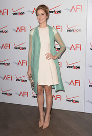 Caitlin Fitzgerald oozed retro charm in a sheer-sleeve pastel-blue coat layered over a little white dress at the AFI Awards.