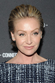 Portia de Rossi sported a short, brushed-back hairstyle at the 2014 AOL NewFronts.
