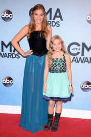 Lennon Stella looked prom-ready at the CMA Awards in a gown with a black bodice and a sheer blue skirt.
