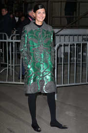 Giovanna Battaglia shimmered in a green and gray sequined coat during the Givenchy fashion show.