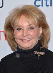 Barbara Walters styled her hair into a teased bob for the 2014 Time 100 Gala.