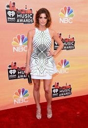 Gold Jimmy Choo strappy sandals finished off Ashley Greene's look in ultra-glam style.