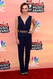 Karina Smirnoff was office-chic in a navy peplum jumpsuit during the iHeartRadio Music Awards.
