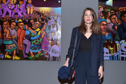 Chalotte Casiraghi attended the 'Art Afrique, Le Nouvel Atelier' exhibition wearing a slouchy navy blazer and matching trousers.