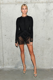 Hailey Baldwin looked sensual in a body-con mesh LBD by Julien Macdonald at the Art + Commerce: The Exhibition opening.