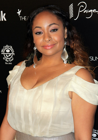 Raven-Symone opted to let her silver dangle earrings shine with a sweet half-up hairstyle.