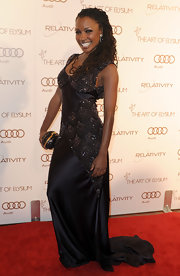 Shanola Hampton showed off her mega-watt smile in a black beaded gown with a swooping train at the Art of Elysium Gala.
