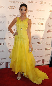Camilla Belle looked like a piece of art in a yellow organza evening dress for the Art of Elysium Gala.