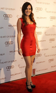 Jackie accessorized her red hot bandage dress with black patent leather Mary Jane pumps.